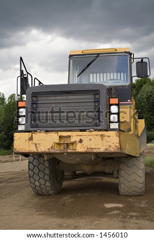 Large earthmover from front.  A stormy sky above. - stock photo