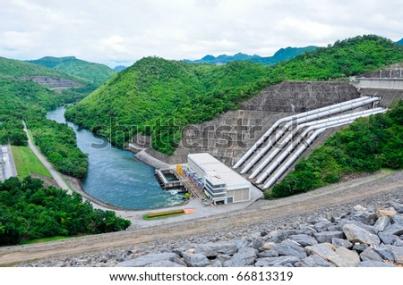 Large electric power dam in valley of western Thailand - stock photo