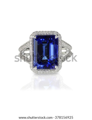 Large emerald cut sapphire engagement fashion ring with halo setting and pave diamonds - stock photo