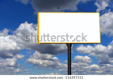 Large empty billboard over dramatic cloudy blue sky - stock photo