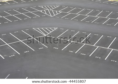 large, empty corner section of parking lot - stock photo