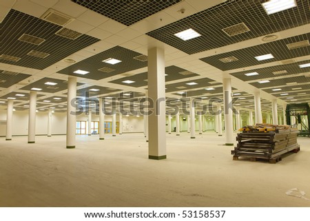 Large empty room in business center - stock photo