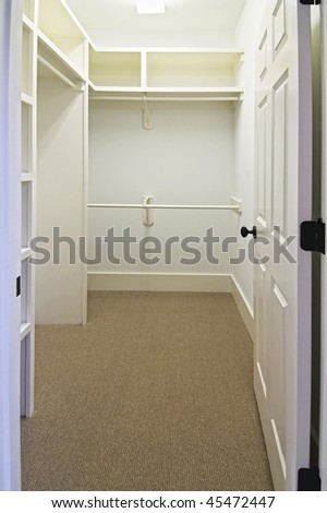 large empty walk in closet with carpet - stock photo