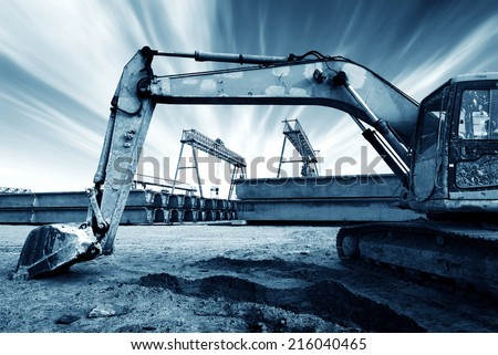 Large excavator at the construction site - stock photo
