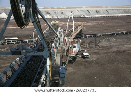 Large excavators in coal mine - stock photo