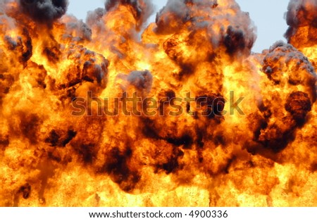Large explosion throwing fire and debris into the sky - stock photo