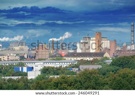 Large factory and dark clouds - stock photo