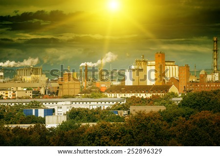 Large factory in the city - stock photo