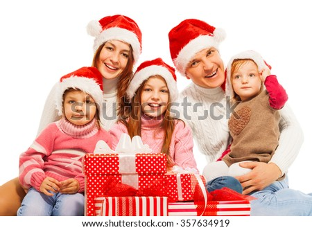 Large family in Santa hat with presents
