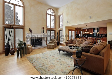 Large family room with two story curved windows - stock photo