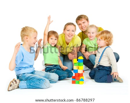 Large family with four children on a white background