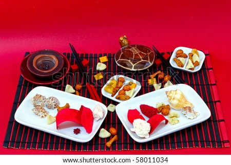 Large fancy table setting for Japanese meal - stock photo