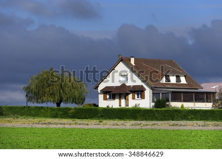 Large farm country house with spring green landscape