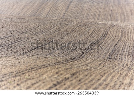 Large field ready for sowing and plowing action in the spring season - stock photo