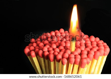 Large fire and matches on a black background.  - stock photo