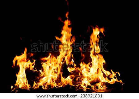 Large Fire burning in the night closeup - stock photo
