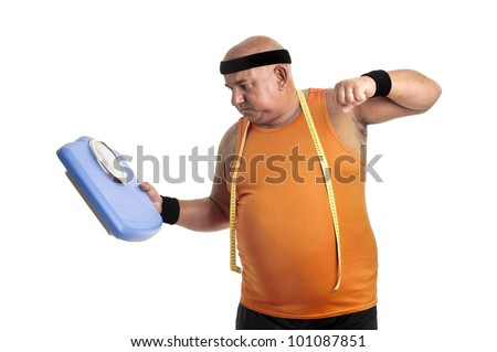 Large fitness man angry with weight scale isolated in white - stock photo