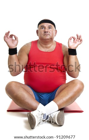 Large fitness man doing yoga exercises isolated in white - stock photo