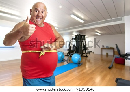 Large fitness man with measuring tape - stock photo