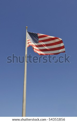 Large flag waving in a blue sky
