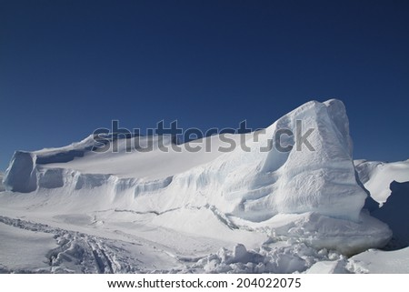 large flat frozen iceberg in the Southern Ocean Antarctic winter