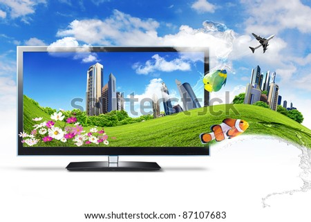 Large flat screen with nature images and nature elements inside and around - stock photo