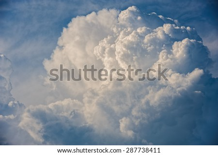 Large fluffy cloud relief details on blue sky - stock photo
