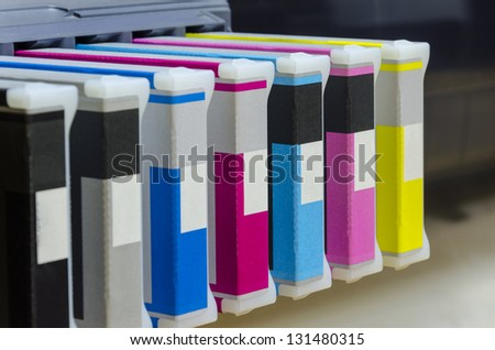 large format ink jet printer cartridge with paper roll - stock photo