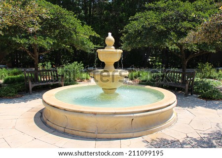 Large fountain in a park - stock photo