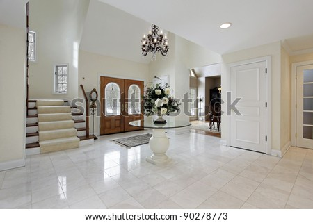 Large foyer with stained glass door windows - stock photo