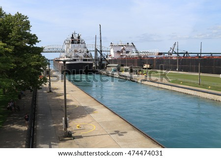 Large freighter leaving the Soo Locks, in Sault Ste Marie, Michigan in the Upper Peninsula.