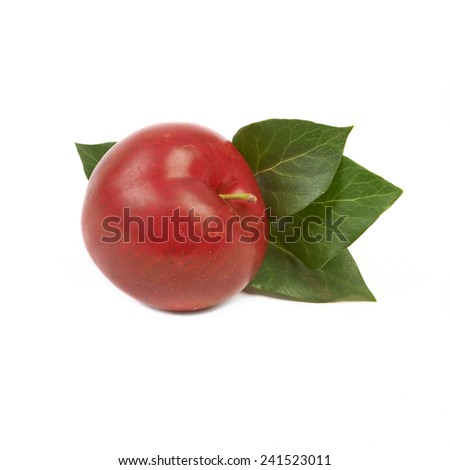 Large fresh ripe plum nectarine with green leaf, healthy ingredient isolated on white background. - stock photo
