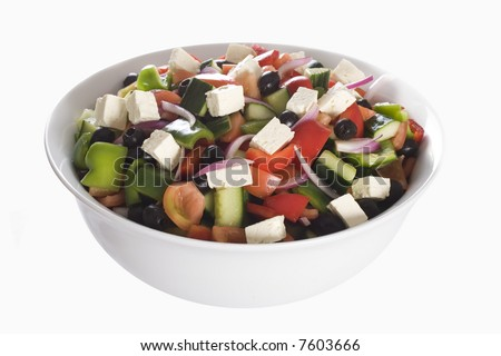 Large freshly made traditional greek salad in white ceramic bowl, isolated on white - stock photo