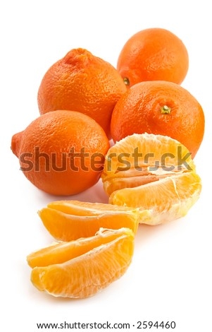 Large fruits of a juicy tangerine and fragrant segments on a white background - stock photo