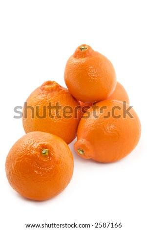 Large fruits of a juicy tangerine on white background - stock photo