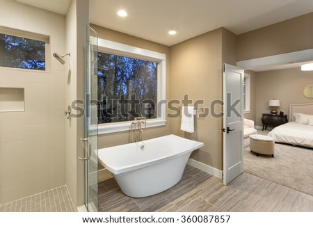 Large Furnished Bathroom In Luxury Home With Tile Floor, Shower, Bathtub,  And View