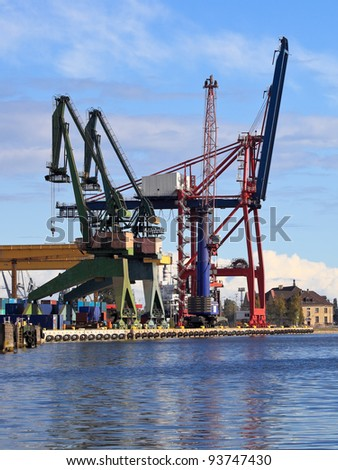 Large gantry cranes at the port of Gdansk, Poland. - stock photo