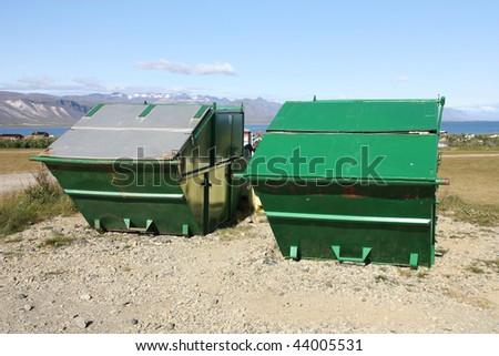 Large garbage dumpsters in Snaefellsnes peninsula, Iceland. Green refuse containers. - stock photo