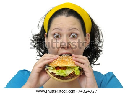 Large girl eating a hamburger isolated in white - stock photo