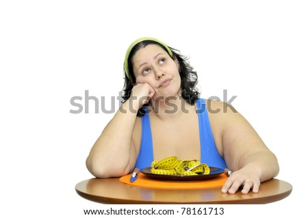 Large girl eating a measuring tape isolated in white