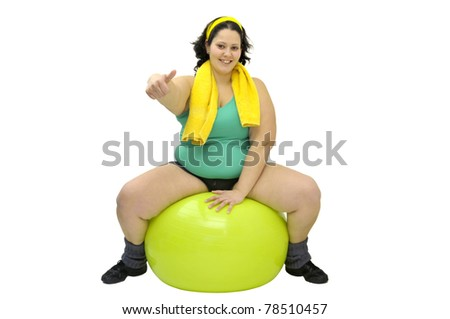 Large girl exercising with a big ball isolated in white - stock photo