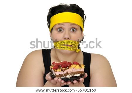 Large girl gaged with measuring tape holding a cake isolated in white - stock photo