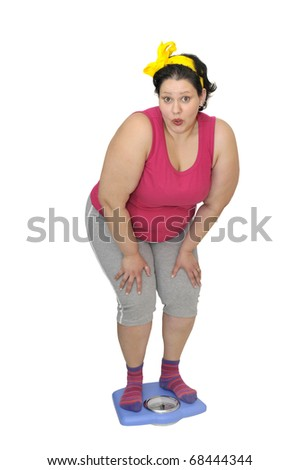 Large girl in a weight scale isolated in white - stock photo