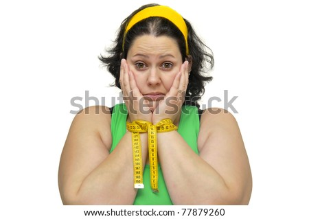 Large girl tied up with a measuring tape isolated in white - stock photo