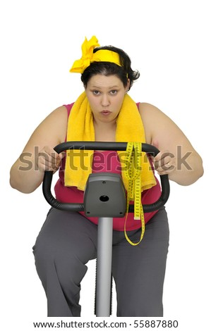 Large girl with fitness bicycle isolated in white - stock photo