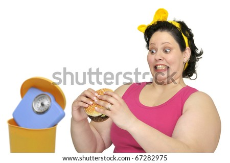 Large girl with hamburger and weight scale in the garbage bin - stock photo