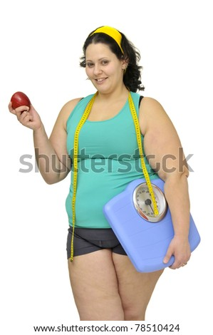 Large girl with weight scale and apple isolated in white - stock photo