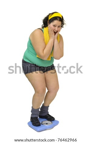 Large girl with weight scale isolated in white - stock photo