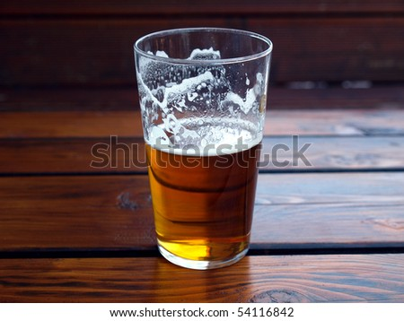 Large glass pint of beer alcoholic drink - stock photo