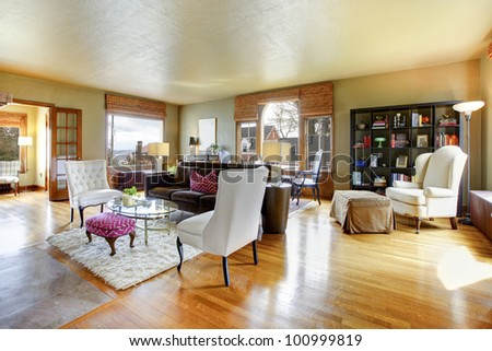Large gold antique living room interior with hardwood floor. - stock photo